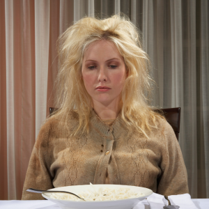 disheveled woman eating gruel